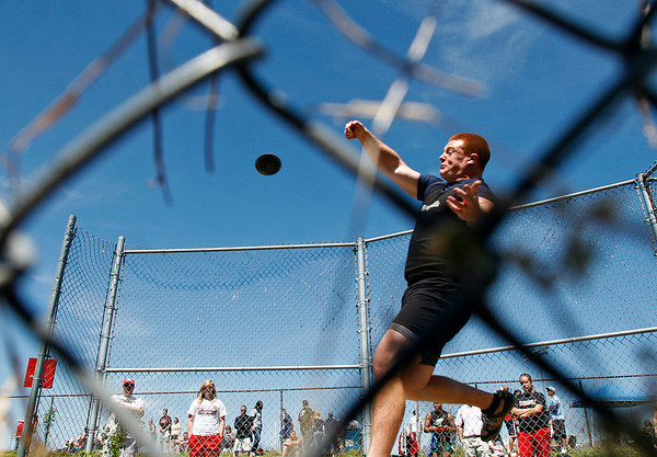 Henryville High School senior Griffin Uhl throws during the final flight of the boys discus competition at the Inferno Classic Track and Field Invitational at Jeffersonville High School on Saturday afternoon. Uhl placed sixth with a throw of 146 feet and 10 inches. Staff photo by Christopher Fryer