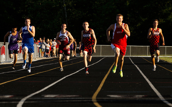Runners move towards the finish line during the 200-meter dash at the Southern Athletic Conference Track Meet in Borden on Thursday afternoon. Staff photo by Christopher Fryer