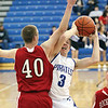 Charlestown senior David Cissell draws a foul on Rock Creek Academy forward Jeremiah Wilkinson on a drive to the basket Tuesday night at Charlestown.  Staff photo by C.E. Branham