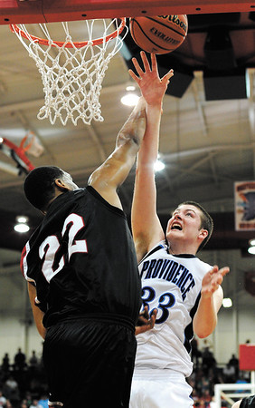 Providence forward Dalton Duley goes up for a shot against Park Tudor forward Trevon Bluiett during their game in the Class 2A semistate tournament at Southport High School on Saturday evening. Park Tudor won the game 62-49. Staff photo by Christopher Fryer