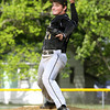 Dakota Harrell works the mound for Henryville as they played at New Washington on Monday afternoon. Staff photo by C.E. Branham