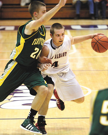 New Albany guard Aaron Schmidt fends off Floyd Central defender Nick Bomersbach in 4A sectional play Tuesday night.  Staff photo by C.E. Branham