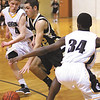 Henryville guard Evan Embry gets around Clarksville defender Calvin McEwen Tuesday night at Clarksville.  Staff photo by C.E. Branham