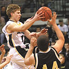 Clarksville senior guard Billy Edelen dishes off in the lane against Henryville Tuesday night.  Staff photo by C.E. Branham