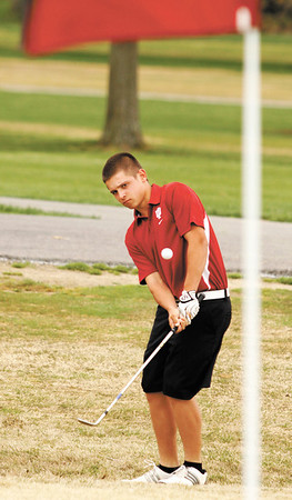 Floyd Central High School junior Devin Jenkins chips a shot on to the first green during practice at Valley View Golf Club on Thursday afternoon. Staff photo by Christopher Fryer