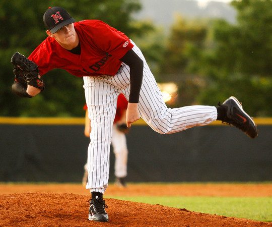 New Albany High School pitcher Josh Rogers pitches during their home game against Providence High School on Thursday night. New Albany won the game 10-0 in six innings. Staff photo by Christopher Fryer