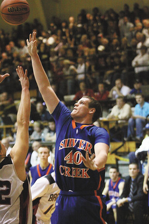 Silver Creek senior Zach McCall scores on the baseline in a 52-50 3A sectional loss to Brownstown Central.  Staff photo by C.E. Branham
