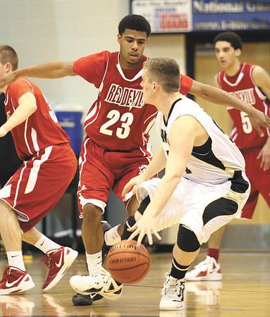 Jeffersonville junior Darryl Baker cuts off Corydon Central guard Justin Yates.  Staff photo by C.E. Branham
