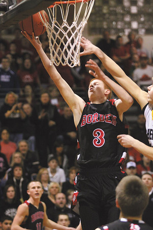 Borden senior Brandon beam scores the first basket in a game at Clarksville Friday night.  Staff photo by C.E. Branham