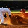 New Albany third baseman Cameron Mullins tags out Jeffersonville third baseman Charlie Garwood as he attempts to steal third during the second inning of their game in New Albany on Wednesday evening. Jeffersonville won the game 4-0 . Staff photo by Christopher Fryer