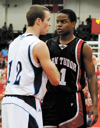"Providence guard Bryce Very and Park Tudor guard Kevin ""Yogi"" Ferrell face off after a rough play during the first half of their game in the Class 2A semistate tournament at Southport High School on Saturday evening. Park Tudor won the game 62-49. Staff photo by Christopher Fryer"