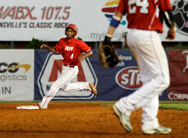 Jeffersonville High School sophomore Damin Smith rounds second base during the fourth inning of their game against New Palestine High School in the Indiana High School Athletic Association 4A Regional tournament at Bosse Field in Evansville on Saturday evening. New Palestine won the game 11-9. Staff photo by Christopher Fryer