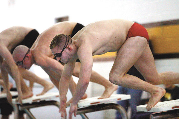 Jeffersonville swimmer Zach Blankenbeker pushes off at the start of the 200 yard freestyle at the boys swimming and diving sectional Saturday.  Blankenbeker won the event in 1:43.49.  Staff photo by C.E. Branham