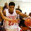 Jeffersonville guard Darryl Baker drives down the court during their game against Bloomington South in the 4A regional tournament at Shelbyville High School on Saturday afternoon. Bloomington South won the game 35-34. Staff photo by Christopher Fryer