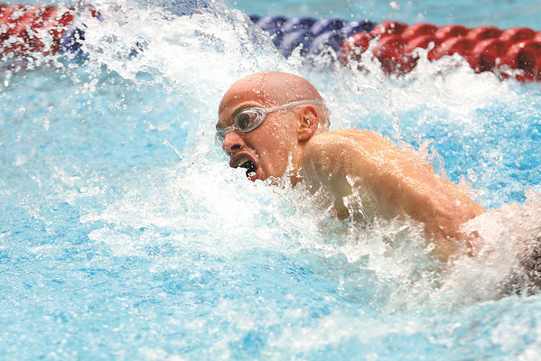 Jeffersonville sophomore T. Martin cuts through the pool en route to a fourth place finish in the 100 yard freestyle Saturday at the IHSAA Boys Swimming and Diving Championship.  Martin swam the race in 46.16.  Staff photo by C.E. Branham
