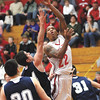 Jeffersonville senior Jordan Ellis scores down low against Bedford North Lawrence Friday night.  Staff photo by C.E. Branham