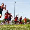 Runners make their way around the first turn during the boys 200-meter dash at the Inferno Classic Track and Field Invitational at Jeffersonville High School on Saturday afternoon. Staff photo by Christopher Fryer