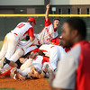 The Jeffersonville High School baseball team piles on the pitchers mound after beating Seymour 6-4 for the 4A Sectional championship. Staff photo by C.E. Branham