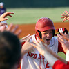 Jeffersonville senior Charlie Garwood is welcomed to the dugout after connecting for a double in the Sectional championship against Seymour. Garwood collected two doubles and a RBI in the win. Staff photo by C.E. Branham