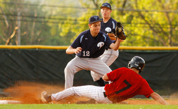 New Albany High School outfielder Shane Robison slides safely into second base past Providence High School infielder Ben Shahroudi during their game at New Albany on Thursday night. New Albany won the game 10-0 in six innings. Staff photo by Christopher Fryer