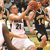 Clarksville junior Aidan McEwen on a drive against Henryville Tuesday night.  Staff photo by C.E. Branham