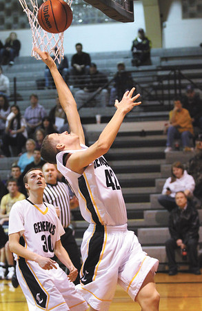 Clarksville senior A.J. Ebling puts up a shot in the first quarter for the Generals against Henryville Tuesday night.  Staff photo C.E. Branham