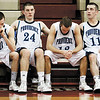 From left, Providence players Aaron Shahroudi, George Knott, Bryce Very, and Colin Daly look on from the bench in the last minute of their game against Park Tudor in the Class 2A semistate tournament at Southport High School on Saturday evening. Park Tudor won the game 62-49. Staff photo by Christopher Fryer