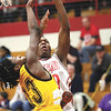 Jeffersonville senior Jonathan Ellis is fouled on a shot by Indianapolis Howe defender Jayme Hill Friday night at Jeff.  The Red Devils closed out the regular season 17-3.  Staff photo by C.E. Branham