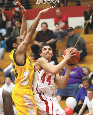 Jeffersonville freshman Myles Harvey draws a foul from a Indianapolis Howe defender Friday night at Jeff.  Staff photo by C.E. Branham