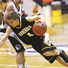 Clarksville guard Calvin McEwen drives around Providence defender Colin Daily in the 2A sectional semi-final Saturday at Paoli.  Staff photo by C.E. Branham