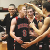 Borden players Brandon Beam, Garrett Vick, Jalen McCoy and coach Doc Nash celebrate toward the end of the Braves 71-51 1A sectional win over South Central Monday night.  Staff photo by C.E. Branham