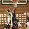 Borden senior Brandon Beam is fouled on a drive to the basket by Henryville sophomore Andrew Jones in the first half.  Beam was whistled a technical after the play.  Staff photo by C.E. Branham