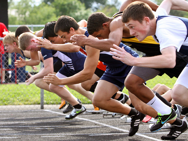 Runners from Clarksville, Providence and Silver Creek push from the blocks at the start of the 100 meter dash. Boys and Girls from the three schools competed in the meet at Clarksville on Monday. Staff photo by C.E. Branham