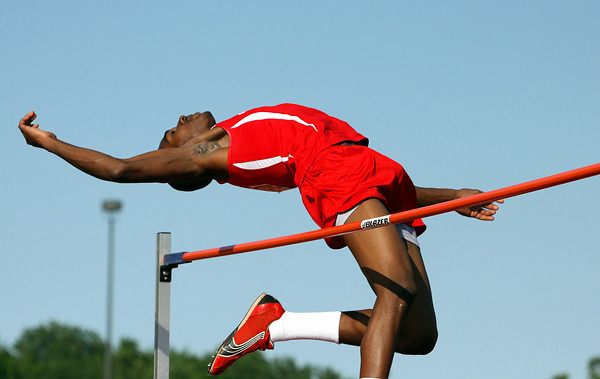 Jeffersonville high jumper Derius Phillips clears the bar in the 2012 IHSAA track and field sectional at Jeff High. Staff photo by C.E. Branham