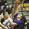 Silver Creek guard Gran Meyer has his shot blocked by Brownstown Central defender Brett McCory in the Dragons 52-50 3A Salem sectional loss.  Staff photo by C.E. Branham