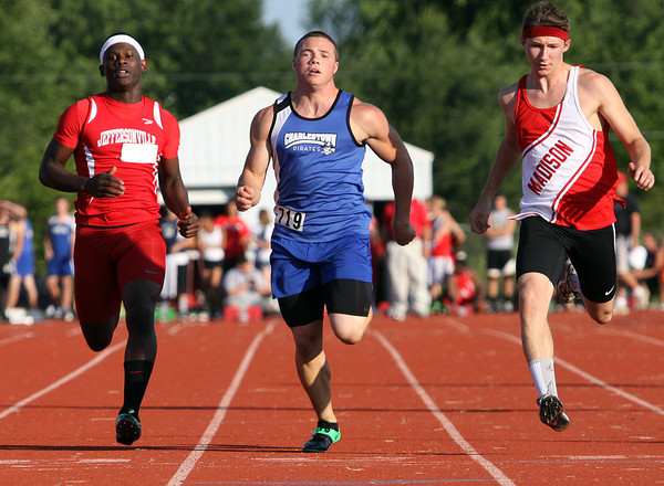 Charlestown freshman Josh Hurley edges out Madison runner Logan Konkle and Jeffersonville runner Isaiah Mack in the 100 meter dash preliminaries of the 2012 IHSAA track and field sectional. Staff photo by C.E. Branham
