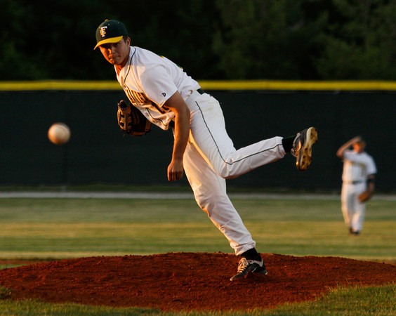 Floyd Central High School junior Kyle Sipes pitches during the first inning of their game against Jeffersonville High School at the Indiana High School Athletic Association Sectional tournament at Jeffersonville on Thursday evening. Staff photo by Christopher Fryer