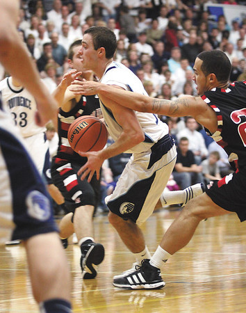 Providence guard Bryce Very finds a seam in the lane to score against New Albany Friday at Providence.  The Pioneers beat the Bulldogs 50-20.  Staff photo by C.E. Branham