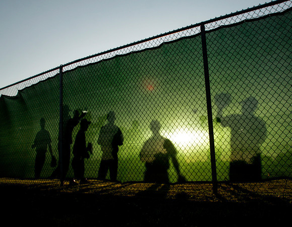 The Floyd Central High School baseball team warms up in the outfield before their game against Jeffersonville High School at the Indiana High School Athletic Association Sectional tournament at Jeffersonville on Thursday evening. Staff photo by Christopher Fryer