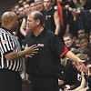 New Albany coach Jim Shannon talks with an official after being whistled for a technical foul by another official Friday night at Providence.  New Albany was held to five points in the first half in a 50-20 loss to Providence.  Staff photo by C.E. Branham