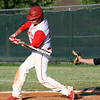 Jeffersonville batter Isaac Crafton, who went three-for-three, connects for a solo homer in the bottom of the eighth inning to lift the Red Devils to a 1-0 win over New Albany in the Hoosier Hills Conference Tournament semi-finals. Staff photo by C.E. Branham