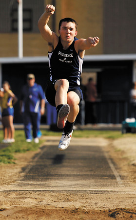 Providence junior Jake Braden competes in the long jump during the Providence Invitational track meet on Wednesday afternoon at Providence High School. Staff photo by Christopher Fryer