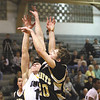 Henryville junior Tyler Collins scores over Clarksville defender Billy Edelen Tuesday night at Clarksville.  Staff photo by C.E. Branham