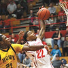 Jeffersonville High School senior Jordan Ellis is fouled by Indianapolis Howe player Tyler Alexander Friday night at Jeff.  Staff photo by C.E. Branham