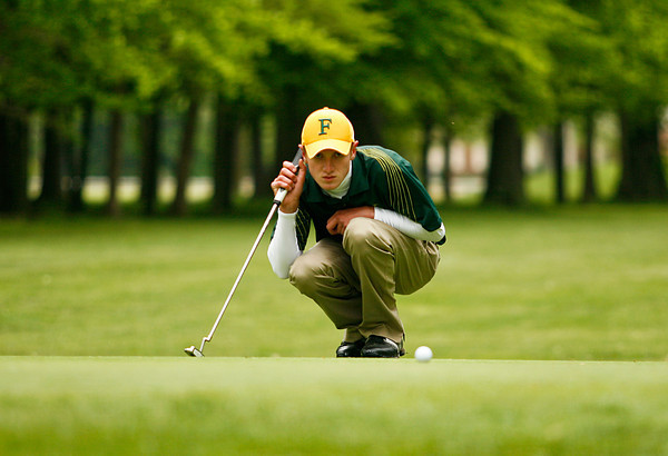 Floyd Central High School senior Jay Holderman lines up a putt on the 12th green at Wooded View Golf Course during the Ron Veleta Invitational golf tournament on Saturday afternoon. Holderman finished six over par with a score of 77 and won the tournament after a sudden death tie breaker. Staff photo by Christopher Fryer