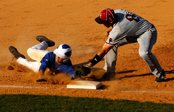 Silver Creek infielder Jamie Valvano barely avoids the tag of South Central third baseman Jason Boston while stealing third base during their game at Silver Creek on Thursday evening. Silver Creek won the game 11-1. Staff photo by Christopher Fryer