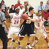 Jeff defenders Marcus Gray (24) and Trice Whaley (3) pressure Bedford North Lawrence guard Blaine Byrer resulting in a turnover.  Staff photo by C.E. Branham