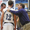 Providence coach Lou Lefevre talks with guard Bryce Very during a 50-20 dismantling of New Albany Friday night.  Staff photo by C.E. Branham