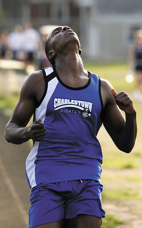 Charlestown sophomore Salih Soodoo crosses the finish line after the 200-meter dash during the Providence Invitational track meet on Wednesday afternoon at Providence High School. Staff photo by Christopher Fryer