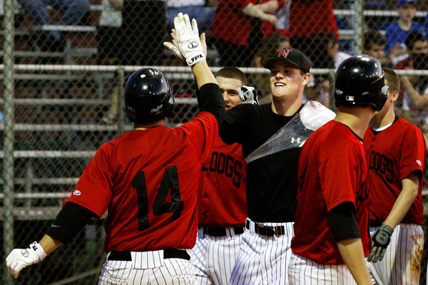 New Albany High School first baseman Eric Burnett is congratulated by his teammates after hitting a home run during the sixth inning of their home game against Providence high School on Thursday night. New Albany won the game 10-0 in six innings. Staff photo by Christopher Fryer
